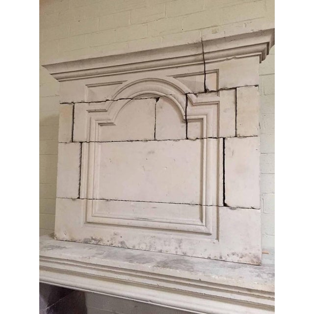 Antique Louis XIV limestone mantel with trumeau that features a semi-quatrefoil design. Measurements: 65″ W x 23″ D x 99...