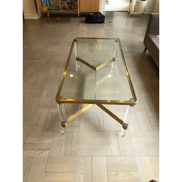 Acrylic and gold brass coffee table with glass top. Inspired by the 70's Yves St Laurent era.