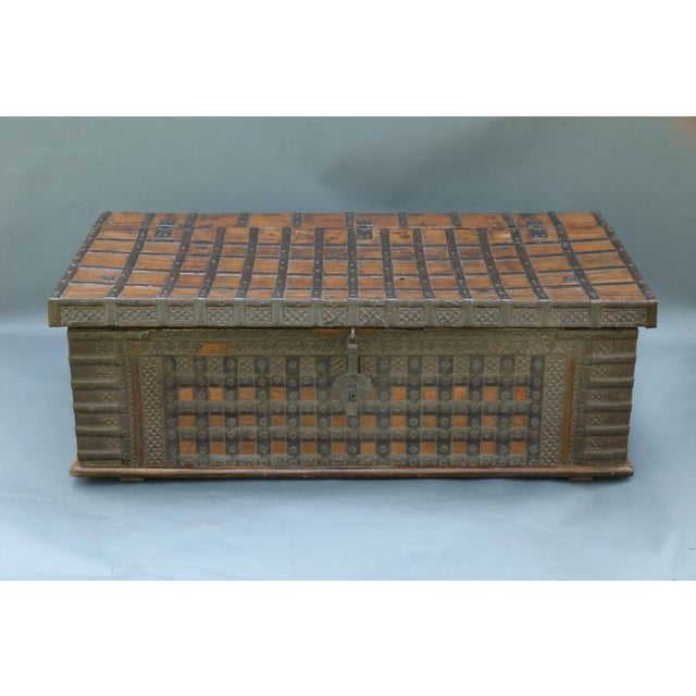 A 19th-Century Anglo-Indian teak iron bound trunk, the perfect coffee table size and height. It is heavy and large, and...