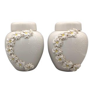 1980's Dorothy Okumoto Hawaiian Porcelain White Ginger Jars With Plumeria Flowers - A Pair For Sale