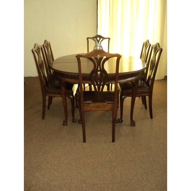 This is a very nice Round Walnut Claw Foot Dining Table with 6 Chairs in style of Chippendale.. it was all refinished some...