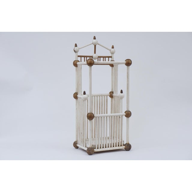 Charming white painted stick and ball umbrella stand with gold details. 19th Century Folk Art Stand. Metal pan at the...