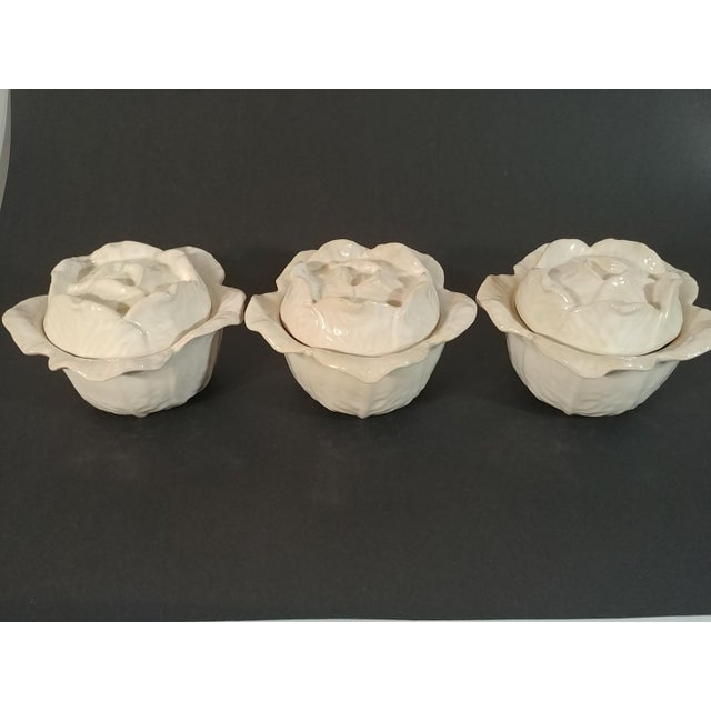 A set of 3 Italian majolica lidded cabbage serving bowls by Peasant Village of Italy. The color is cream with a touch of...