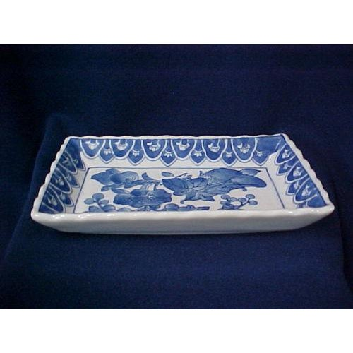 Relish Dish This Asian style relish dish is white with blue design. The shape is rectangular and the edges are scalloped....