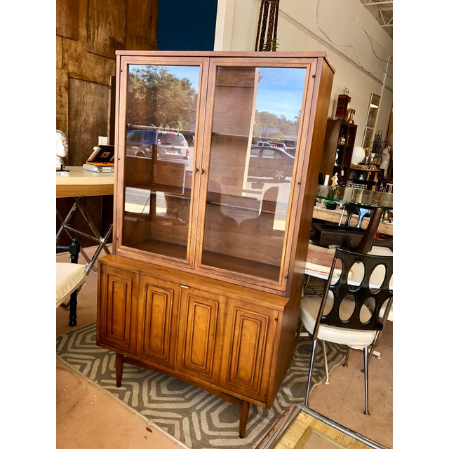 Unique china cabinet in great condition for age. Use in the dining room or office. Top does disconnect if desired.