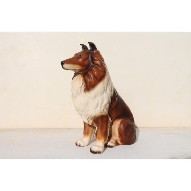 Mid century glazed and detailed ceramic sculpture of a beautiful dog.