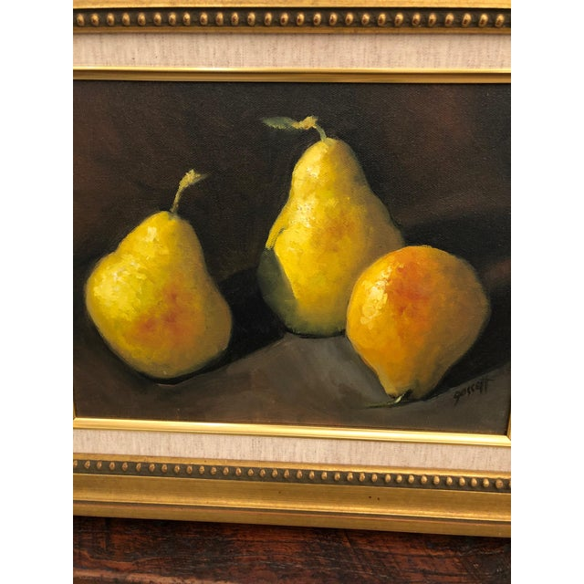 Two beautifully rendered realistic still life paintings on canvas of lime green pears against a black background,...