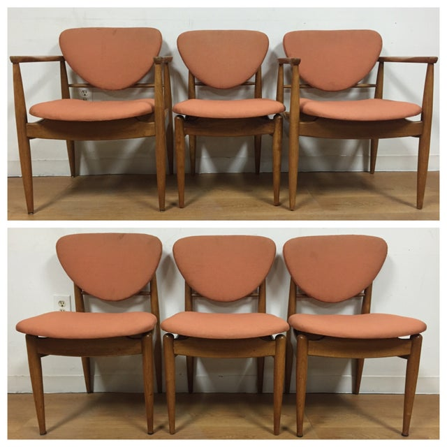 A set of six mid century modern bleached walnut John Stuart floating dining chairs with two arm chairs and four side...