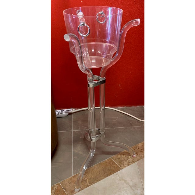 Dorothy Thorpe designed clear wine bucket and Lucite tripod stand. You don't often find the the stand and bucket still...
