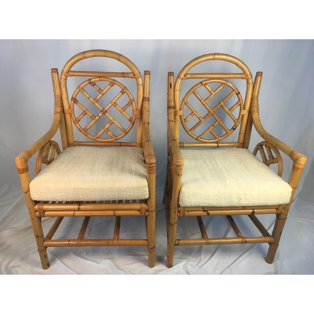 One of the best pairs of vintage rattan chairs I've seen! The great aged color, the Chippendale style and the fabulous...