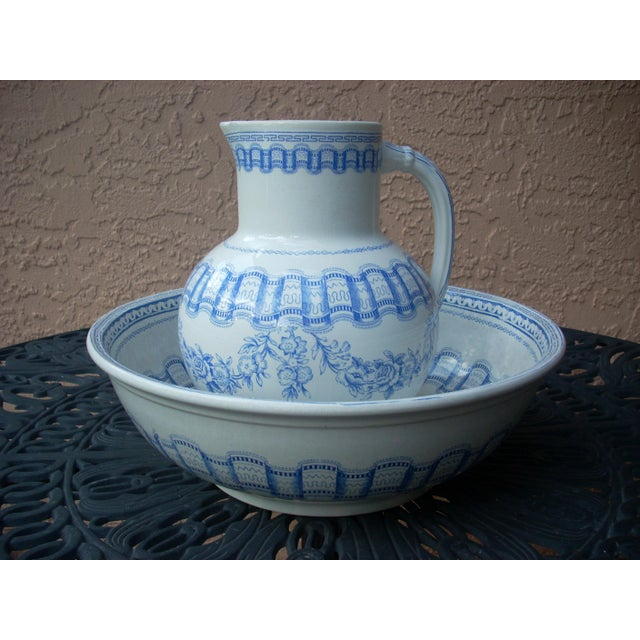 "A classic blue & white pitcher and wash bowl; bottom of each piece is marked ""Diane"" and embossed diamond shape with the..."
