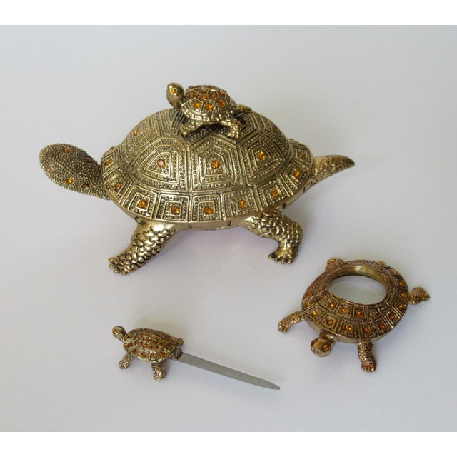 Contemporary; Greek key design brass gilded and bejeweled, turtle-shaped, hinged back, lidded keepsake box, desk set...