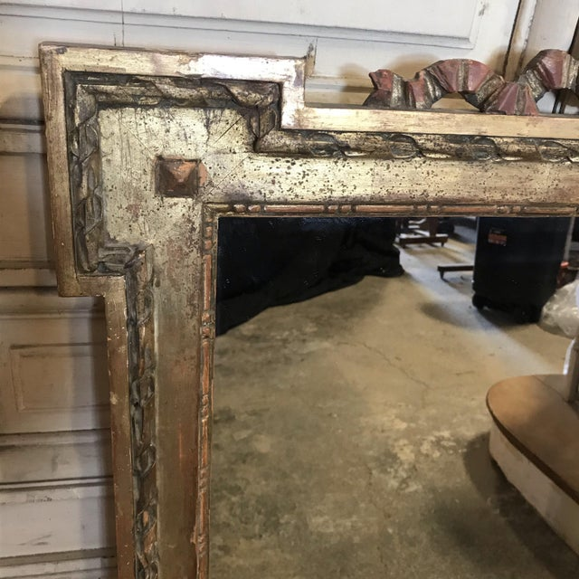 French antique giltwood mirror with original gold gilt having beautiful ribbon and bow at the top and corner finial design.