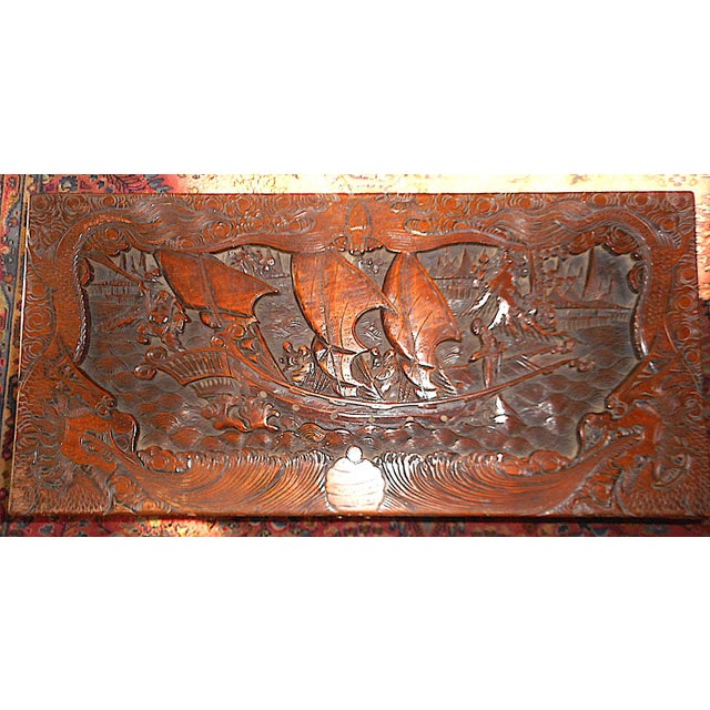 This is an original antique Chinese heavily hand carved mahogany chest (or coffee table with camphorwood lined interior...