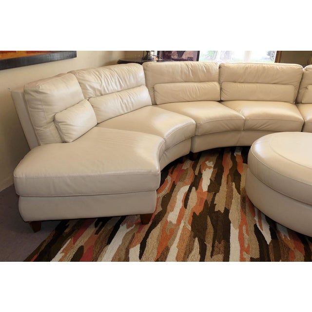 Circular leather sectional made in Italy by Chateau d'Ax. This 5-piece modular sectional plus ottoman features clean lines...