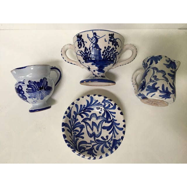 Lovely, petite sized, mid century blue and white hand painted pieces from Italy. There are four pieces in all. Each is...