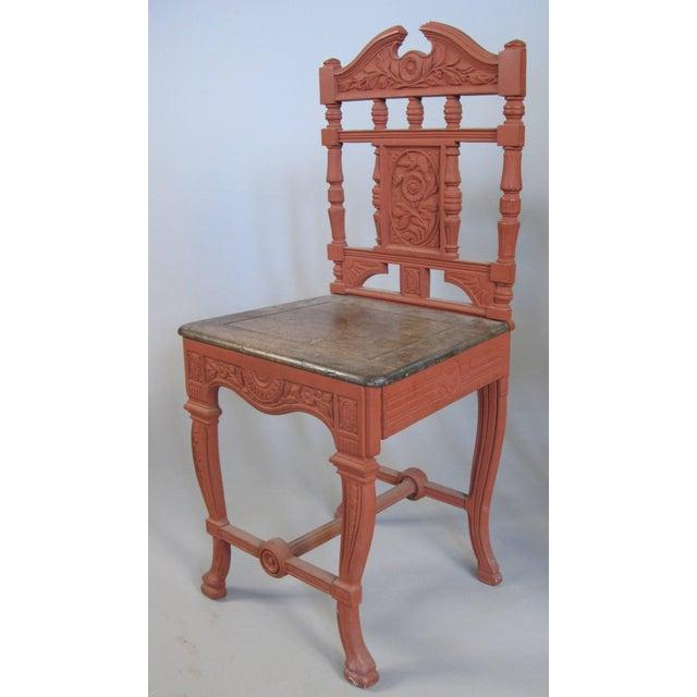 a very handsome pair of English cast iron chairs, circa 1881, with beautiful patterns in the cast iron, and wood seats.