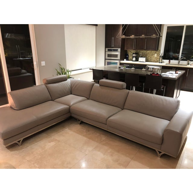 This sofa was purchased in mid 2010 directly from Roche Bobois. It is a beauitful light gray leather sofa which has been a...