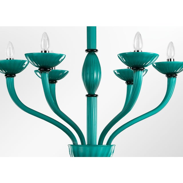 Italian Venetian chandelier shown in opaque sea green Murano glass with ribbed décor / Also shown in opaque amethyst...