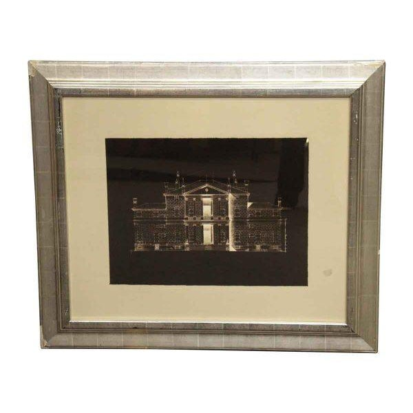 Newly framed rectangular silver painted wood frame with a gray matting encasing a black and white photo of a house.