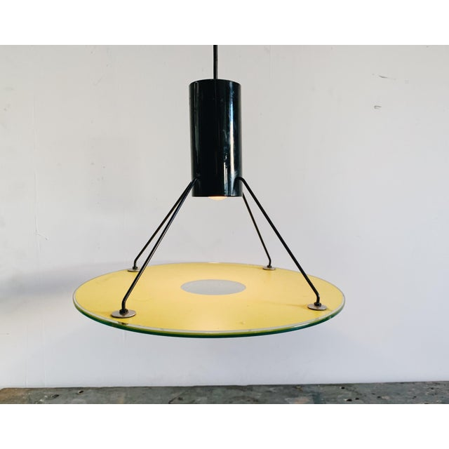 Post modern enameled steel and glass pendant. Please note this lamp takes a standard incandescent bulb, or LED/CFL...