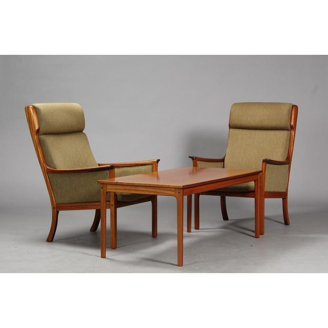 Pair of high-back mahogany armchairs and coffee table by Ole Wanscher for P. Jeppesen. High-backed lawn chairs with solid...