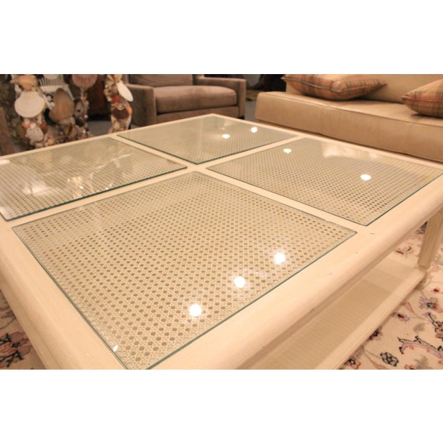 Caned top coffee table in light tan. Perfect for an indoor patio or lavish living room