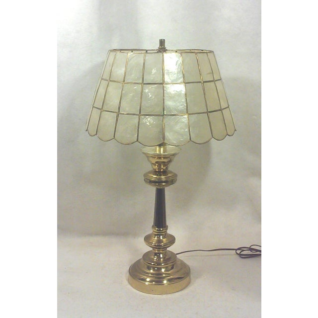 Brass table lamp with capiz shell lamp shade in good vintage condition with working three socket. Few spots of age...
