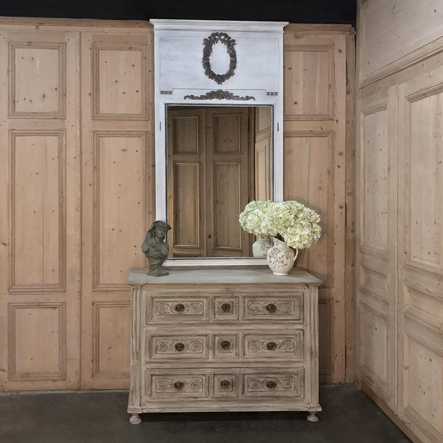 19th Century Neoclassical Painted Trumeau Mirror features tailored architecture, a splendid floral wreath in full relief...
