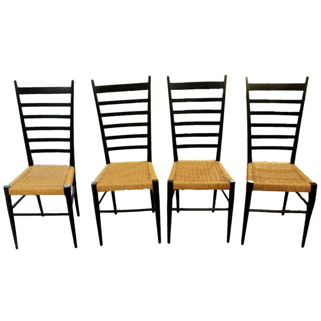 A set of 4 ladder back chairs. Italian, c. 1970-80. Ebonized, tapered & turned legs and rear stiles. Manner of Gio Ponti....