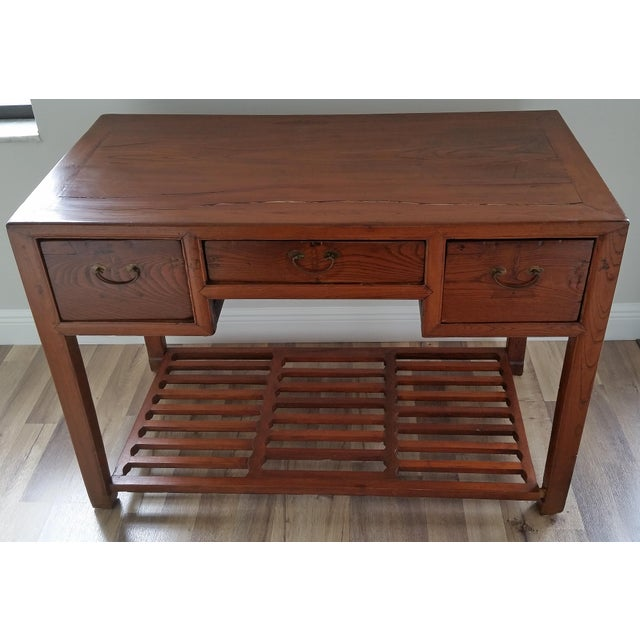 Antique Chinese writing desk with lattice foot rest. The desk has 3 large dove tail construction drawers, one of them with...