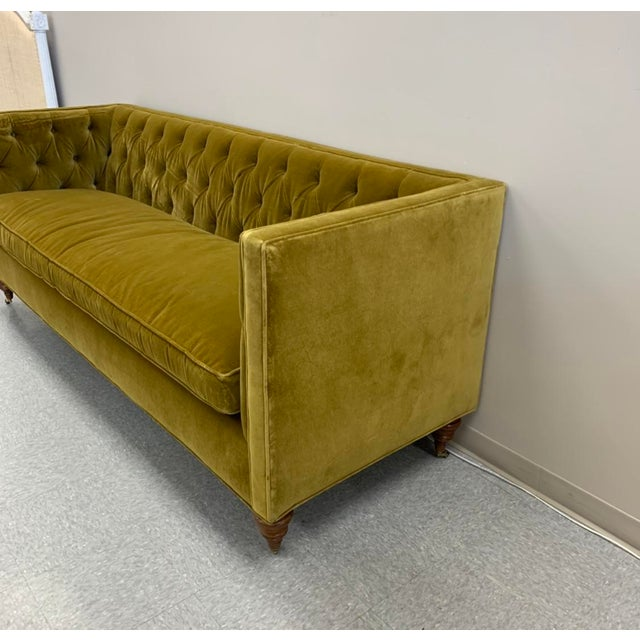 Eye-catching sofa in a stunning yellow green mohair velvet. This sofa features a bench cushion with a feather down fill....