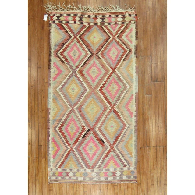 A vintage turkish kilim with beautiful array of colors. circa mid 20th century. Kilims, primarily refer to a type of flat...