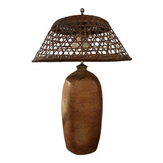Custom Brown Ceramic Pottery Lamp With Wicker Shade For Sale