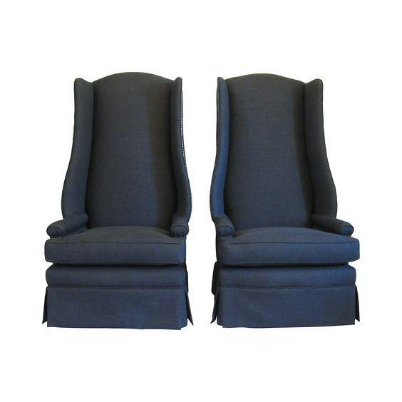 Unique pair of monumental wing back chairs. These chairs have been restored including refinished legs, new foam and...