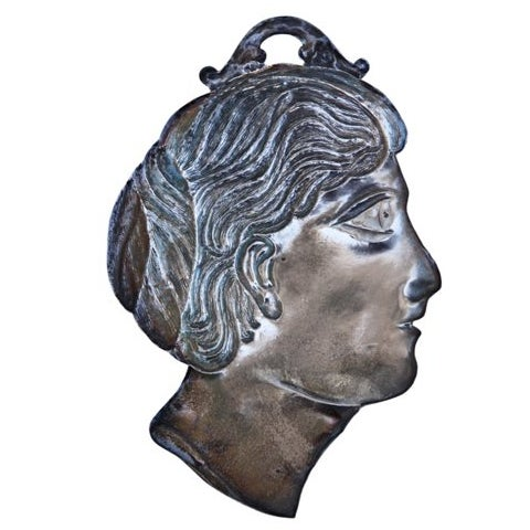 Italian ex-voto of a profile of a man's face, marked: 800. Made of European silver. An exvotive is used as an offering to...