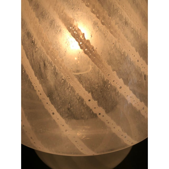 A Mid-Century Modern Italian swirled white Murano glass mushroom table lamp from Vetri. Perfect for a side table, shelf or...