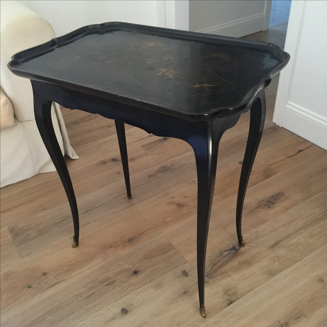 Offered is a lovely antique side table. This piece is black with gold designs, possibly with a Chinese motif. The seller...