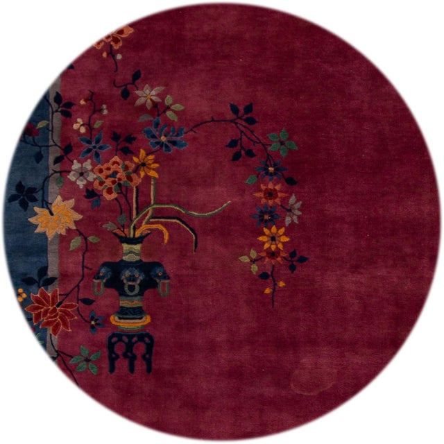 Beautiful antique Chinese Art Deco rug, hand knotted wool with a burgundy field, blue accents in an all-over Classic...