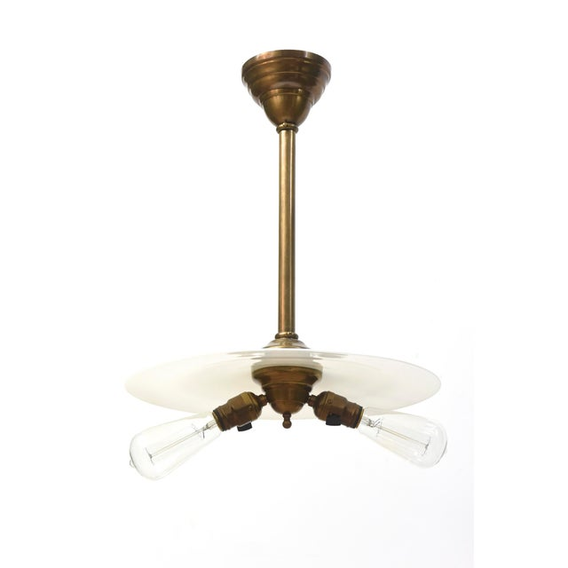 Early electric pendant with two exposed bulbs and the original white shade. Completely restored with an antique brass...