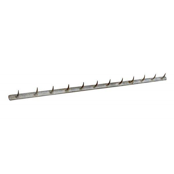 Long thin butcher's rack with 12 hooks, made of cast iron.
