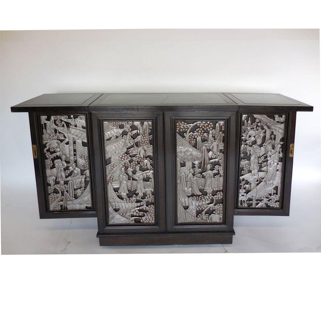 Vintage Chinese folding dry bar. Hand-carved, painted motifs on cabinet panels and doors, circa 1970s. To close the bar,...