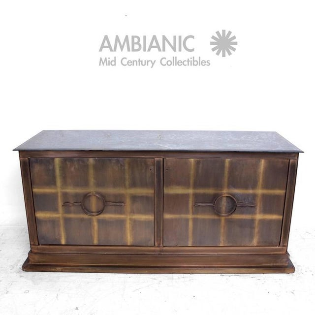For your consideration a pair of bronze credenzas. Constructed with solid sheets of bronze and metal frame. Eglomized...