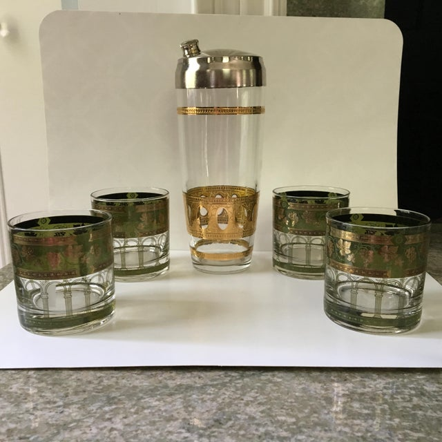 """""""Shaken Not Stirred""""! Vintage, heavy glass martini/drink shaker with gold designs and chrome lid. The lid has a chrome..."""