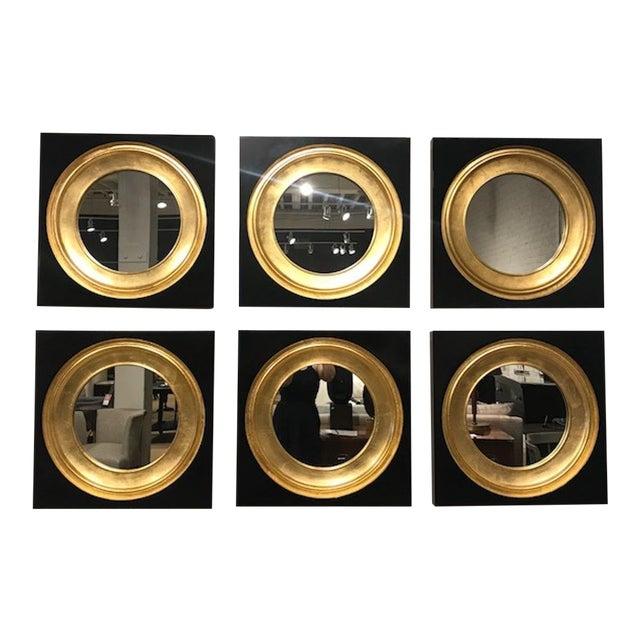 The Gemma Mirror by Alexa Hampton has a neoclassical derived shape that gives a spirited twist to the bulls eye mirror....
