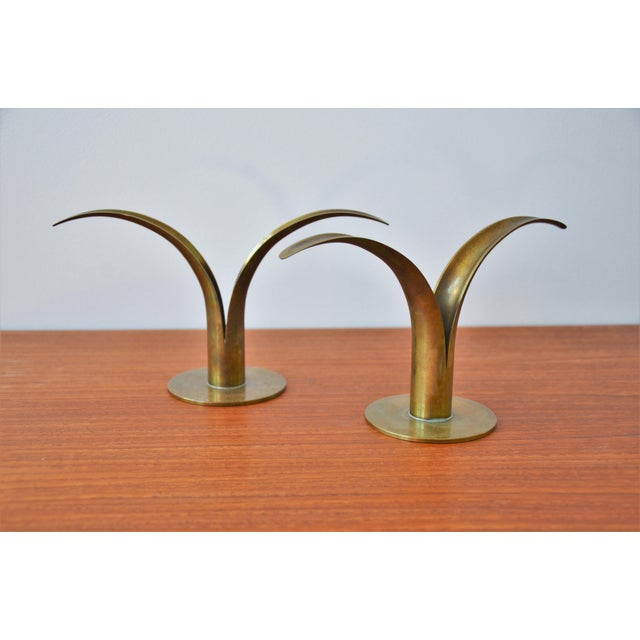 "The ""Lily"" Candlesticks designed by Ivar Ålenius Björk and produced by Ystad Metall in Sweden The pair is in excellent..."