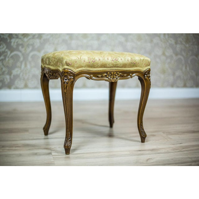 We present you this stool from the 1950s-1960s, stylized as the Rococo furniture. The frame is wooden, with cabriole legs...