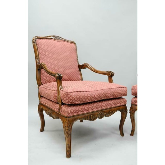 Pair of 20th century, high quality, country French / Louis XV style shell carved living room lounge chairs by Century...
