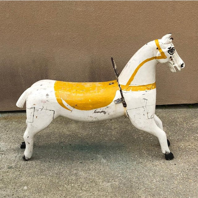 19th Century Hand-Painted Carved Wood Carousel Horse is a splendid artifact of nostalgia, back when huge, brightly lit...