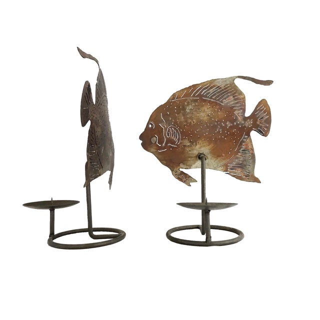 This is a pair of cast metal wrought artwork handcrafted fish candle holders. Amazing pierced pattern which let the soft...